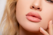 Beautiful Lips Close-up. Makeup. Lip Matte Lipstick. Sexy Lips. Part Of Face, Young Woman Close Up. Perfect Plump Lips Bodily Lipstick. Peach Color Of Lipstick On Large Lips. Perfect Makeup.