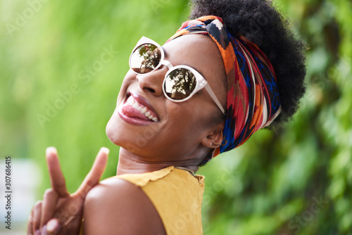 Attractive young african american woman listening to music at a