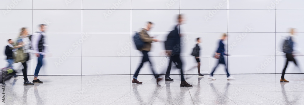 Fototapety, obrazy: Anonymous blurred crowd on the go at a business trade fair