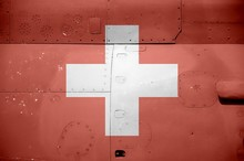 Switzerland Flag Depicted On Side Part Of Military Armored Helicopter Closeup. Army Forces Aircraft Conceptual Background