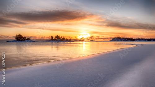 Vászonkép  wide beach and winter sunrise on the lake Ladoga island Kajosaari Republic of Ka