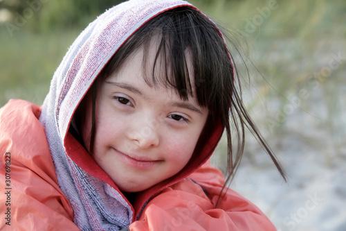 Obraz na plátně  Portrait of little girl smiling outside