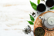 Chinese Green Tea In A Cup With A Kettle. On A White Wooden Background. Top View. Free Space For Your Text.