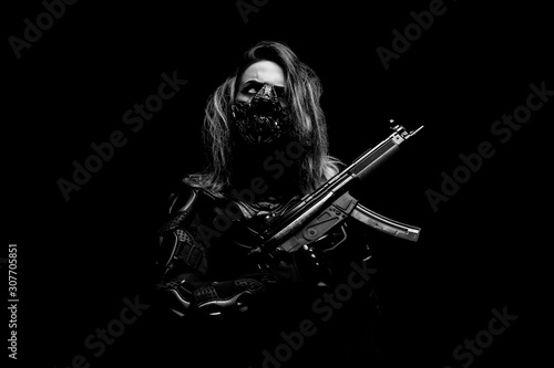 Young one-eyed Cyborg, wearing a mask, in combat armor, holding a machine gun in Poster Mural XXL