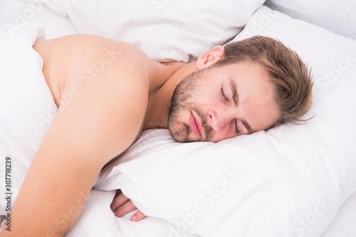 Fényképezés Man handsome unshaven guy in bed