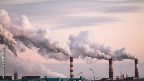 industrial chimneys with heavy smoke causing air pollution as ecological problem Fototapete