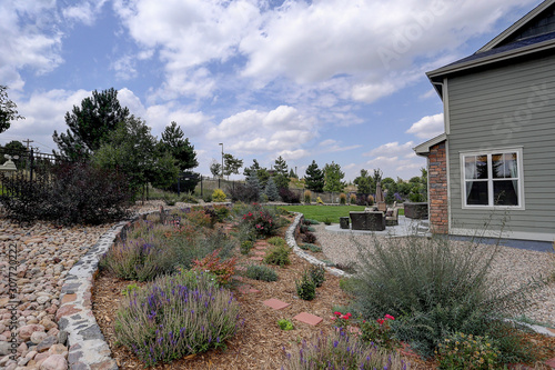 Beautiful  residential rock, stone, and plant xeriscape landscaping in arid clim Wallpaper Mural