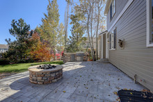 Back Stone Patio With Fall Tre...