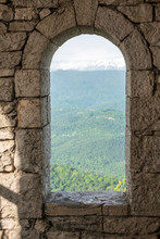 A Narrow Window In An Old Towe...