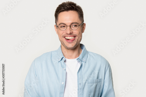 Funny laughing stylish man in glasses posing at photo studio Canvas Print
