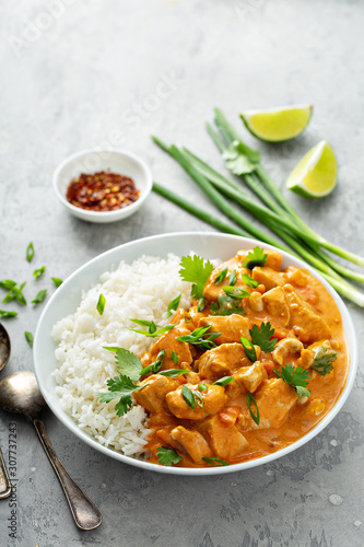 Valokuvatapetti Chicken and cashew red curry with rice and herbs, thai inspired dish