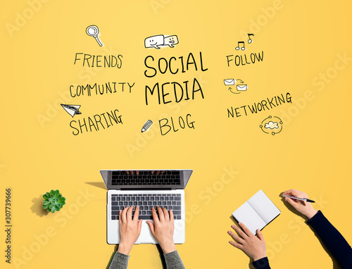 Social media theme with people working together with laptop and notebook