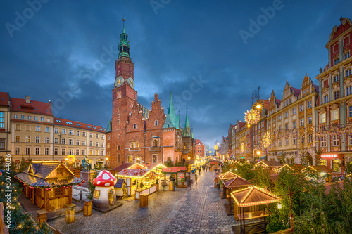 Christmas market on Rynek square at dusk in Wroclaw, Poland