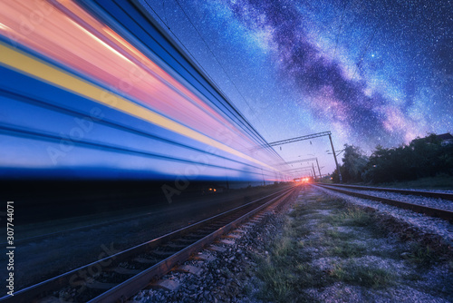 Pinturas sobre lienzo  High speed train in motion and Milky Way at starry night