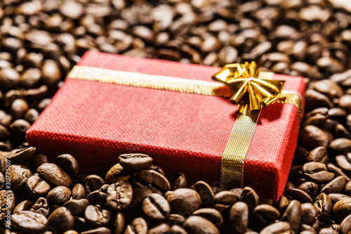 Red gift box on roasted coffee beans. - 307751077