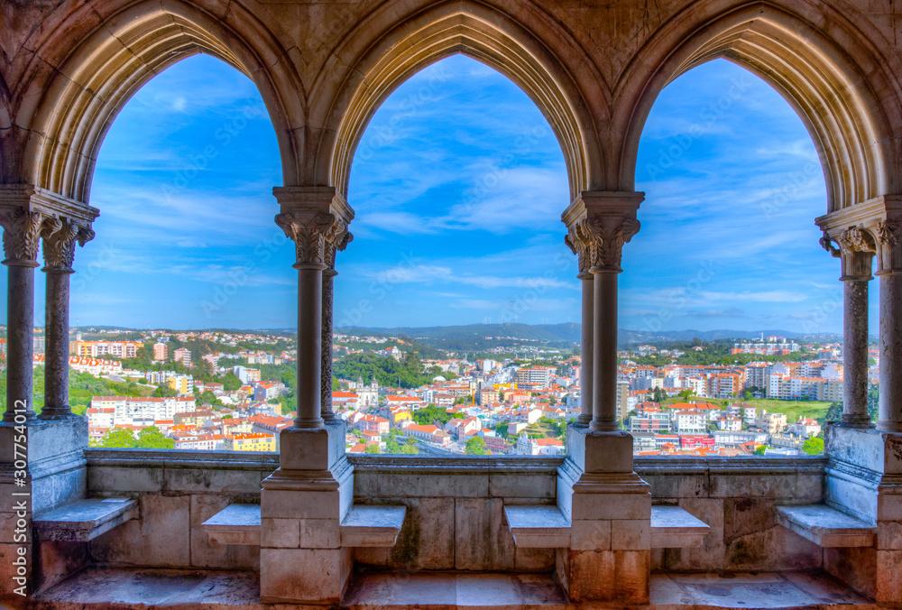 Fototapeta View of Leiria through arcade of the local castle, Portugal