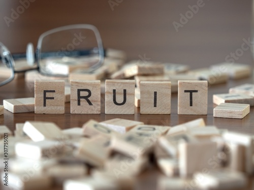 Photo fruit the word or concept represented by wooden letter tiles