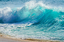 Turquoise Colored Breaking Wave Seascape On The Beach