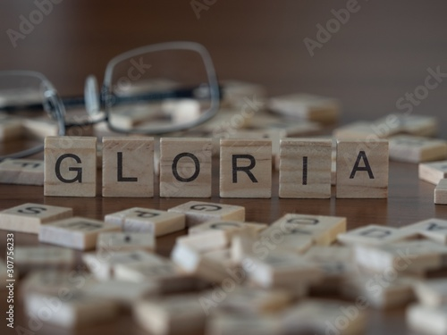 Photo gloria the word or concept represented by wooden letter tiles
