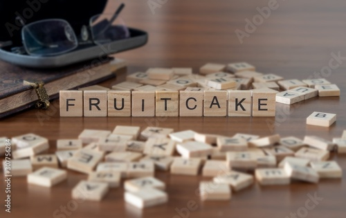 Photo  fruitcake the word or concept represented by wooden letter tiles