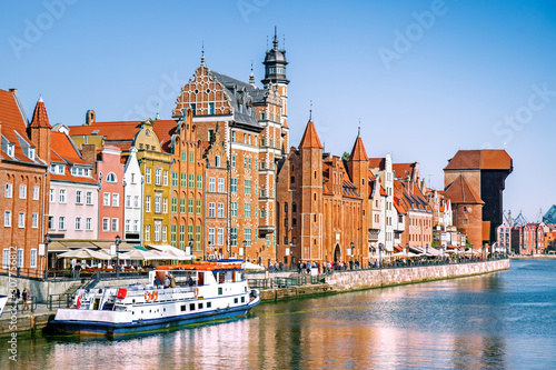 Obraz Scenic embankment of the Motlawa river with historical buildings in Gdansk, Poland - fototapety do salonu
