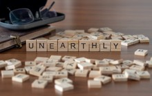 Unearthly The Word Or Concept Represented By Wooden Letter Tiles