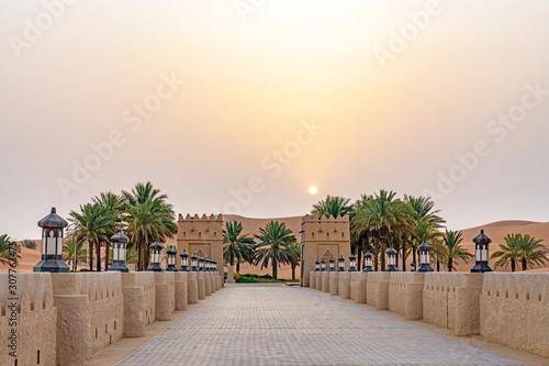 Fototapeta Qasr Al Sarab in Liwa, Al Dhafra, Abu Dhabi, United Arab Emirates at sunrise. obraz