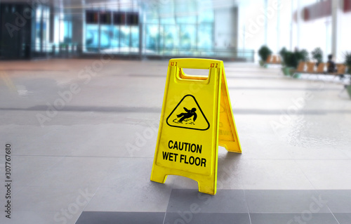 Caution wet slippery floor sign in the building Fototapet