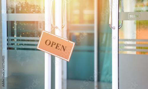 Obraz open sign door glass in the shop - business sign open come hang in cafe restaurant door slide - fototapety do salonu