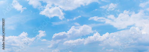 Panorama or panoramic photo of blue sky and white clouds or cloudscape Wallpaper Mural