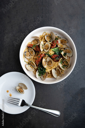 Overhead  shot of a bowl of linguini and clams - 307785411
