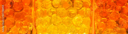Abstract background with yellow and orange bubbles for design - 307786458