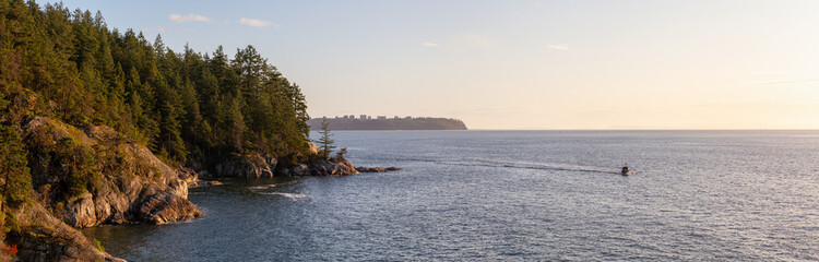 Panoramic View of Rocky Coast in Lighthouse Park, West Vancouver, British Columbia, Canada, with UBC in background. Taken during a cloudy sunset.