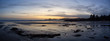 Long Beach, Near Tofino and Ucluelet in Vancouver Island, BC, Canada. Beautiful Panoramic view of a sandy beach on the Pacific Ocean Coast during a vibrant and colorful sunset.