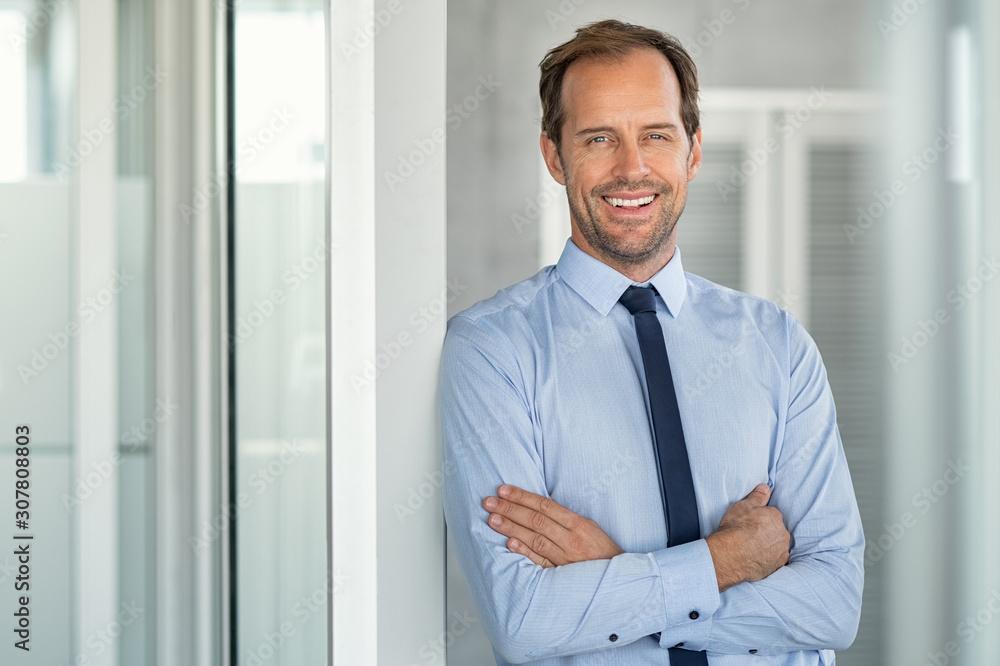 Fototapeta Successful mature business man in modern office