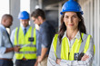 Confident architect at construction site