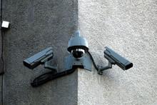 Surveillance Cameras On The Corner Of Building