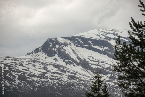 Fototapeta High mountain covered with white snow