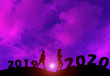 canvas print picture - silhouette Running exercise. concept New Year's Eve welcome New Year celebration 2020.