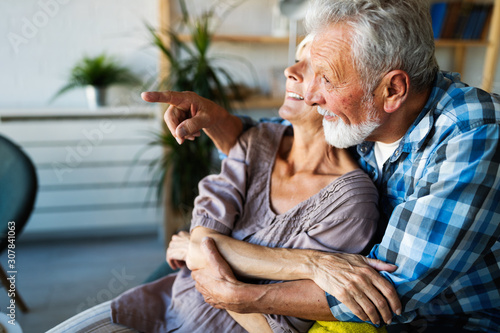 obraz dibond Happy senior couple in love hugging and bonding with true emotions at home