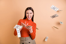 Portrait Of Her She Nice Attractive Lovely Pretty Cool Cheerful Cheery Confident Straight-haired Girl Throwing Money Away Isolated Over Beige Pastel Color Background