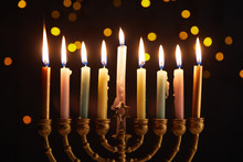 Burning Candles In Menorah On Black Background With Bokeh Lights On Hanukkah