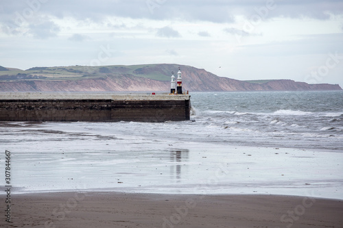 Canvas Print Ramsey Beach in winter with harbour and lighthouse, Isle of Man