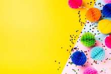 Festive Yellow Background With Colorful Paper Balls. Greeting Card Concept Voor Birthday, Party, Invitation, Carnival. Copy Space, Top View, Flat Lay.