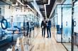 Multiracial business people having conversation in office corridor