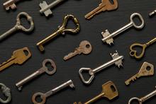 Seamless Pattern With Vintage Rusty Keys On Black Background