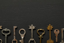 Flat Lay With Vintage Rusty Keys On Black Background