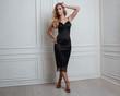 Leinwanddruck Bild - Cute blonde woman in gorgeous black dress