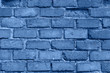 Old red brick wall in Italy. Faded red color, a bit dirty. Copy space for text. Toned in modern blue color 2020