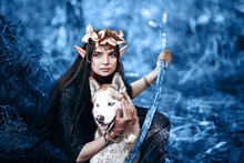 Colorof Year, 2020. Beautiful Fantasy Elf Woman With Dog Blue Eyes Outdoor, Toned Classic Blue Photo